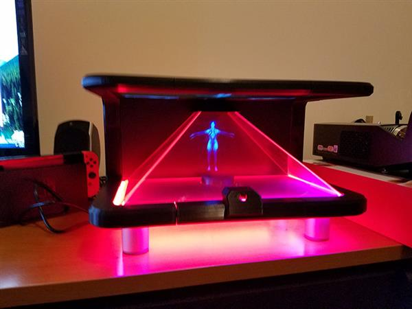 Specialized mirror glass reflects a 3D printed hologram display at an angle producing a translucent image